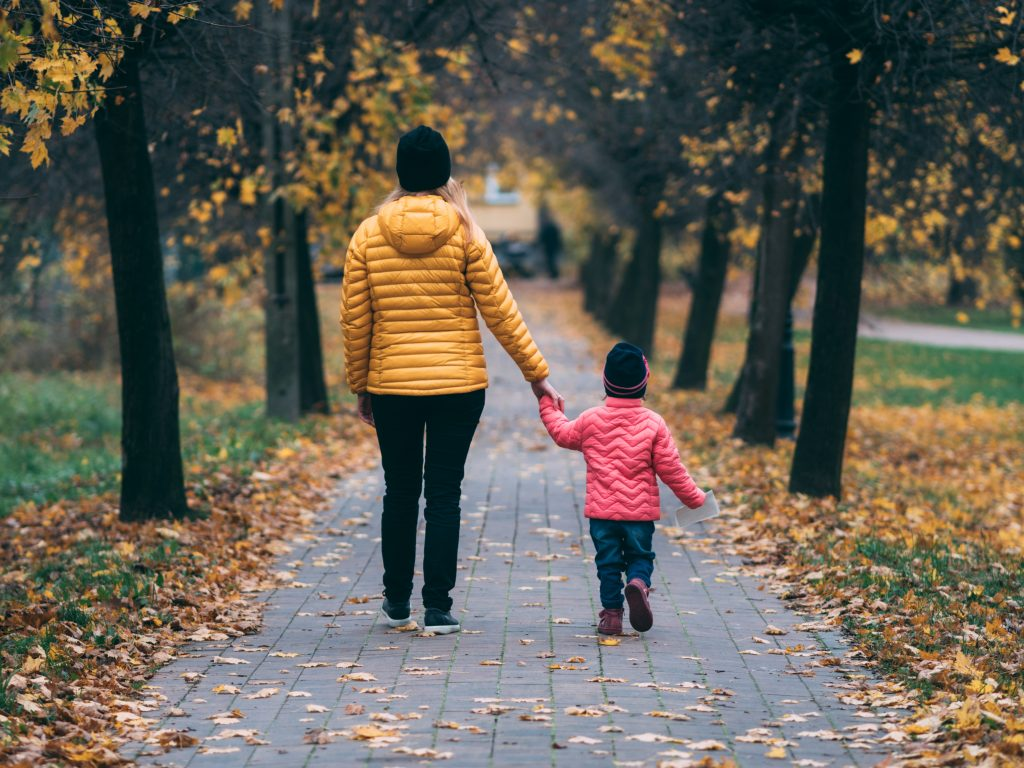woman and child walking hand in hand showing they have energy