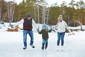 family skating on frozen lake